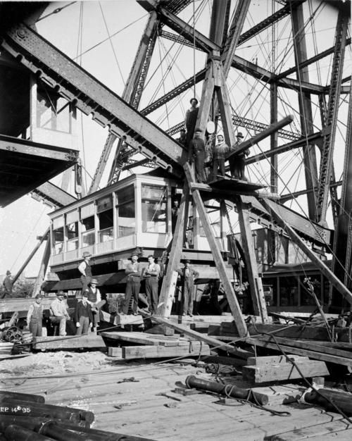 scan from 4x5 BW copy negative. Crew working on Ferris wheel reconstruction on Clark Street. Re-erection of Ferris Wheel on N. Clark St., 1895.